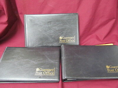 Set of 3 Guernsey Post Office Stamp Albums with extra Stamps