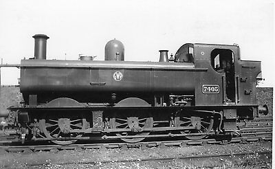 Photo GWR 0-6-0T No 7405 seen at unknown shed yard in GWR livery