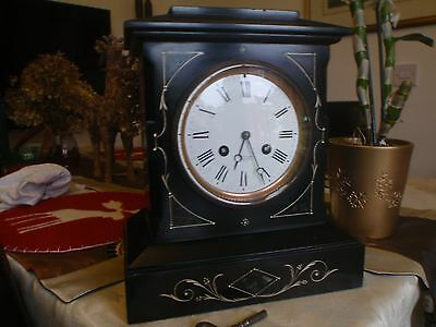 Antique black and gold marble mantel striking clock
