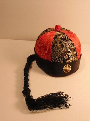 a humorous older souvenir Chinese hat with faux pig tail - great costume item