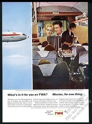 1964 TWA airlines stewardess and movie on plane photo vintage print ad