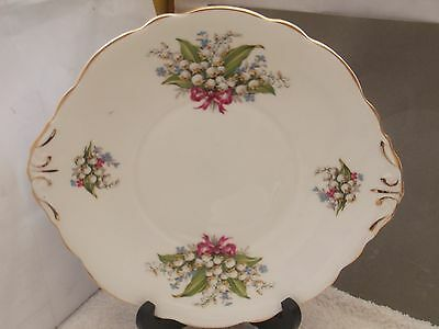 Twin- Handled Bread Plate With A Lily Of The Valley Pattern  By Regency China