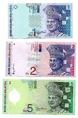 MALAYSIA  1 / 2 and 5 Ringgit -  A  Set of 3 Crisp UNC  Banknotes