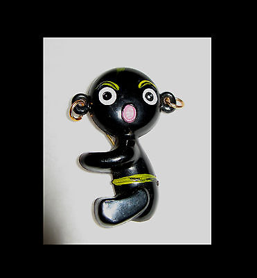 Rare Collectable Plastic Brooch in the shape of a black baby Hong Kong 1970s