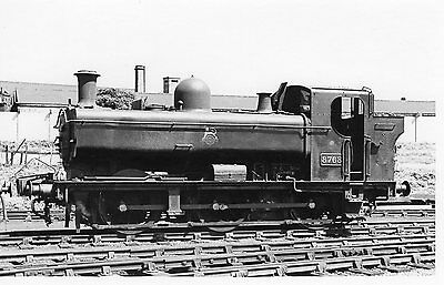 Photo Ex GWR 0-6-0T No 8768 seen here at Old Oak Common shed yard on 8/8/63