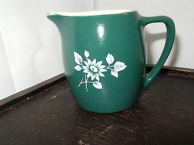 Small Devon Pottery In Dark Green With A White Flower Pattern