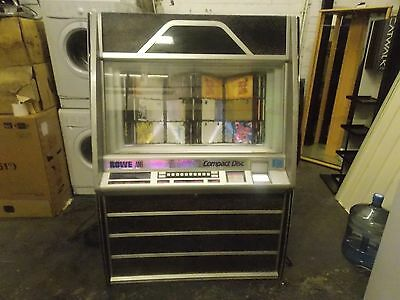 Rowe Ami CD100A jukebox with 100 cd,s mixed classic and disco / dance 100 discs