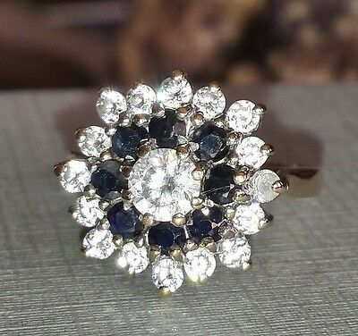 9kt gold cubic zirconia & blue sapphire cluster ring.