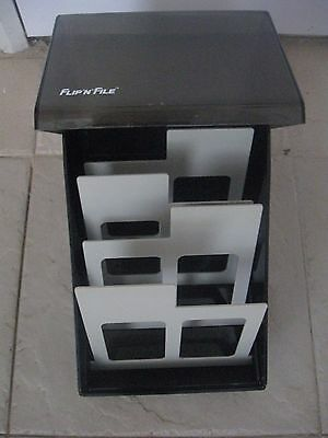 """FLIP'N'FILE COMPACT DISC HOLDER, 4 DIVIDER TABS, HOLDS APPROX 50 CDS, 7""""x7""""x8"""""""