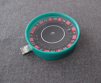 Vintage Tin & Green Plastic Push Button Spinning Roulette