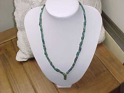 string of  Roman dark green  coloured glass  beads circa 100-400 A.D.