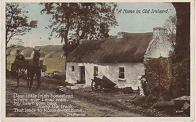 A Home in Old Ireland. Old postcard in fair condition. Written and posted