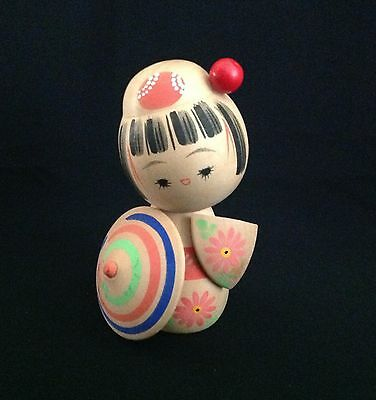 ANTIQUE JAPANESE KOKESHi WOODEN DOLL IN CREAM WITH COLORFUL UMBRELLA STAMPED
