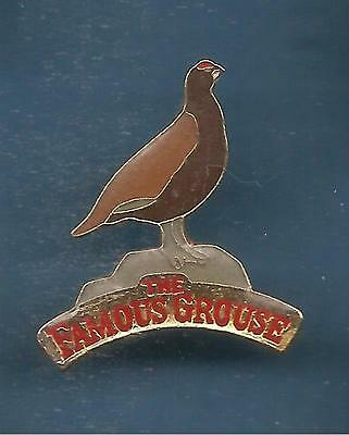 Pin's pin WHISKY THE FAMOUS GROUSE (ref L06)
