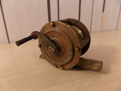 """Very Unusual Small 1.5"""" Wide Brass Fishing Reel In Good Solid Condition"""