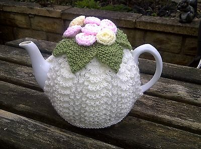 Hand knitted tea cosy with roses. Cream. Vintage style, afternoon tea, cozy