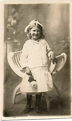 Pretty Young Girl in chair holding a rose.Photographic Postcard,SEE SCAN