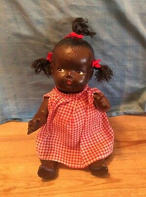 """VINTAGE 10"""" black Composition baby doll with molded hair and 3 tuffs unmarked"""