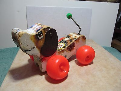 Pre-owned 1968 Fisher-Price No. 693 Little Snoopy pull toy missing the cord.