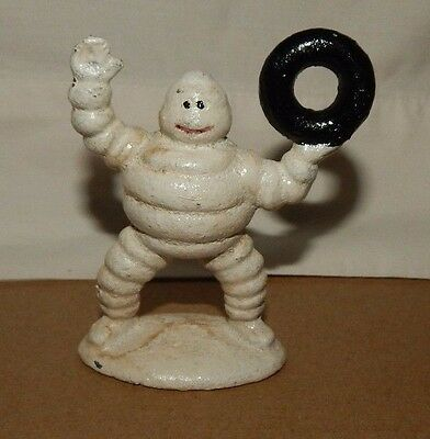 MICHELIN TIRE MAN FIGURINE HOLDING TIRE UP Cast Iron Collectible Paperweight Adv