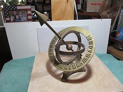 Gold/brass toned unbranded sundial yard ornament.