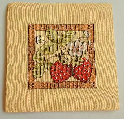 Swedish cross-stitched square picture with stawberries on peach-colored fabric