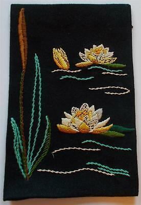 Swedish hand-embroidered sampler, water lilies and reeds on black background