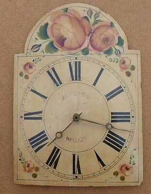 An Old Wall Clock With Woode Face And Brass Weights