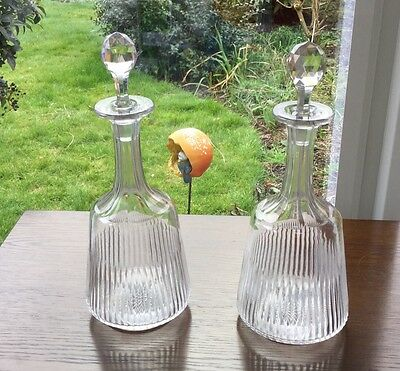 Pair of elegant early 20thC slice cut glass decanters