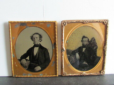 pair of 1/2 plate ambrotype photographs & one is purple glass