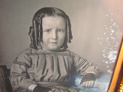 young child with curls daguerreotype photograph