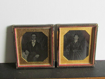 pair of husband & wife daguerreotype photographs with same backdrops