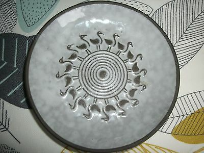 scandinavian art pottery wall hanging plate with bird design 13cm dia signed h.s