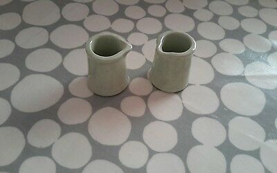 Pair of pale green Grindley England, creamers. 5.5cm high, 4.5cm wide at base.