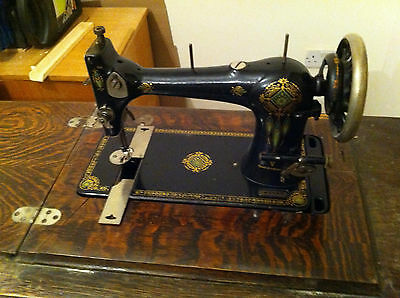 Antique Treadle Sewing Machine in wood table