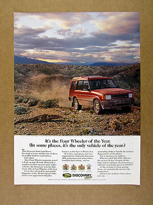 1995 Land Rover Discovery driving in desert photo vintage print Ad