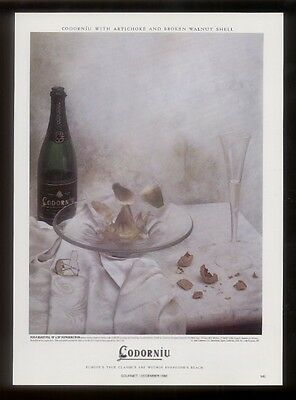 1986 Codorniu wine bottle and champagne glass photo vintage print ad