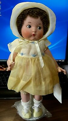 Just me The Vogue Doll company.  2002 all porcelain. 14 nch in yellow