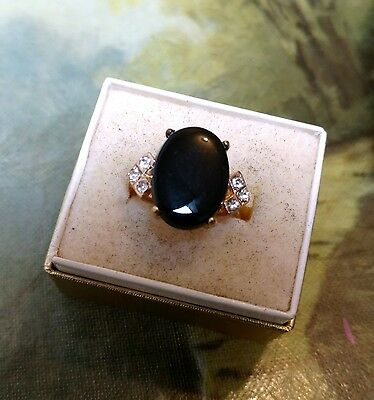 """Black Tourmaline Oval 3/8"""" x 5/8"""" & 3 Accents Each Side Prong Set Gold Tone Ring"""