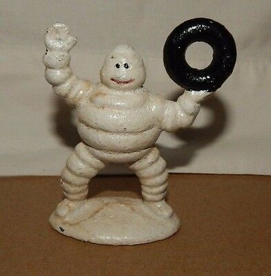 MICHELIN TIRE MAN FIGURINE HOLDING TIRE UP Cast Iron Paperweight Advertising da