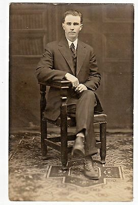 Vintage Real Photo Postcard Of A Man Sitting In A Chair