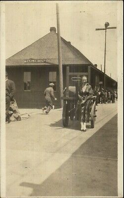 Harlowton MT Woman Poses at RR Train Station AMATEUR Real Photo Postcard spg