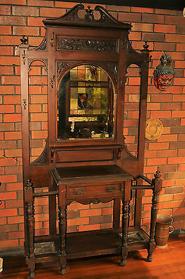 Antique maple hall stand with fauna carving