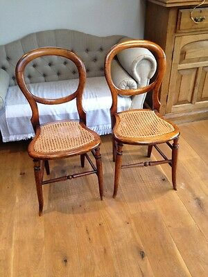 Pair of Gorgeous Victorian child's ballon back cane chairs