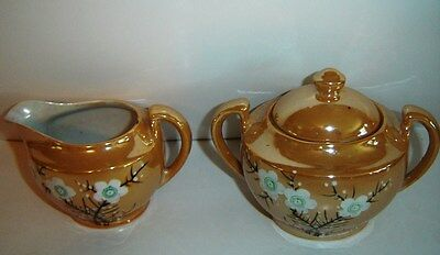 VINTAGE GOLD LUSTER SUGAR and CREAMER WITH HAND PAINTED ORIENTAL FLOWER PATTERN