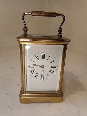Antique Brass cased  Striking Carriage  Clock