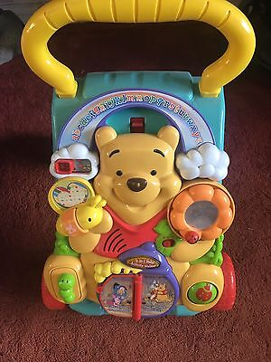 """Baby Push Along Walker """"Winnie The Poo"""" used Vtech musical"""