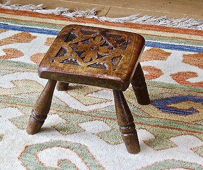 Small antique oak stool with hand carved top