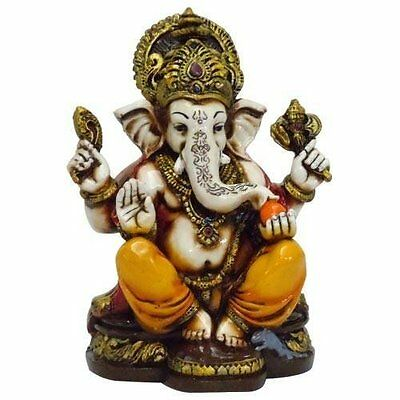 The Blessing. A colored & Gold statue of Lord Ganesh Ganpati Elephant Hindu God