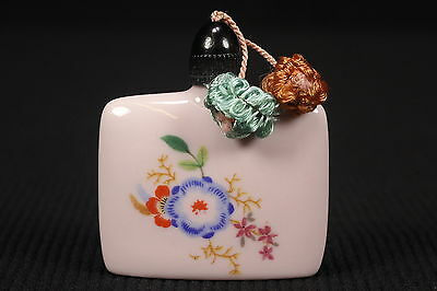 "Pink Ceramic Tiny Perfume Bottle Floral Designs & Black Cap W/ Tassles 2 3/8"" T"